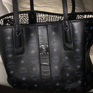 mcm tote with dust bag/authentication card.